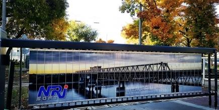 Снимки на Явор Мичев красят бариерите на жп прелез към кея